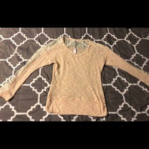 A pink long sleeve shirt with lace